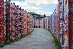 Brick path through a garden of colorful kimono fabrics in Kyoto, Japan Royalty Free Stock Photos