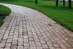 A brick path in the park long Stock Image