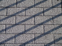 Brick pathway with shadow lines crossing over it Stock Image