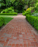 Brick pathways through a garden Stock Photography
