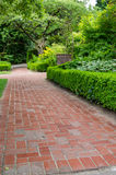 Brick pathways through a garden Stock Photos