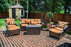 Brick Patio and Furniture. A large Brick Patio and matching outdoor furniture Royalty Free Stock Images