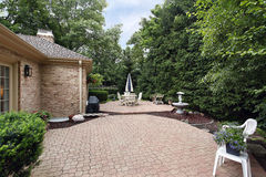 Brick patio with rock garden Stock Image