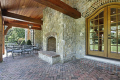 Brick patio with stone fireplace. Brick patio outside luxury home with stone fireplace Royalty Free Stock Photos