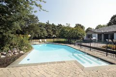 Brick patio and swimming pool. Luxury home with brick patio and swimming pool Stock Images