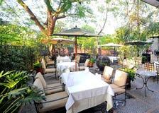 Brick patio with table umbrella Stock Photography