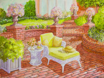 Brick Patio with Wicker Lounge Chair. A white wicker lounge chair, holding a straw hat and a book, is on a brick patio in an acrylic painting Royalty Free Stock Images