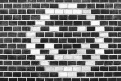 Brick pattern 3. Background of smiley pattern on brick wall Royalty Free Stock Image