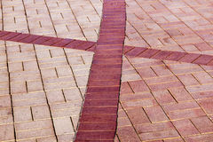 Brick Paved Promenade Background With Red Cross Shape Stock Photos