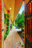 Brick paved walkway leading to the front yard Royalty Free Stock Images
