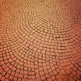 Brick pavement  vintage effect. Bright roadway with arc motifs. Royalty Free Stock Photography