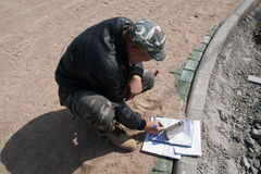 Brick Paver Worker. Perform calculations Stock Photography