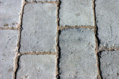 Brick Pavers as a Background. A background of brick pavers lined up on the street Royalty Free Stock Photo