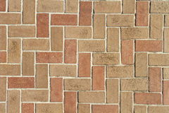 Brick Pavers Background Texture From Above. A red and brown clay brick pavers walkway or driveway background texture in a Herringbone 90 degree pattern. Non Royalty Free Stock Photography