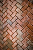 Brick pavers covered in grime. Brick pavers in a herringbone pattern covered in salt and grime Royalty Free Stock Image