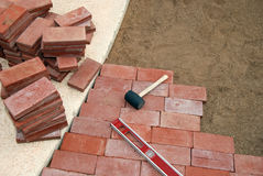 Brick Paving Tools Royalty Free Stock Photography