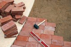 Brick Paving Tools. Basic tools for laying brick pavers Royalty Free Stock Photography