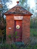 A Brick Privy. This is a Spring picture of a brick outhouse located on the grounds of the Big Bay Lighthouse in Big Bay, Michigan.  The structure was built in Royalty Free Stock Photos