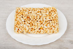 Brick of puffed rice in glass plate on table Royalty Free Stock Image