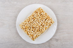 Brick of puffed rice in glass plate on wooden table Stock Images