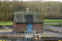 The brick pump house. A solidly built red brick `cottage` housing a pump house in a sewage farm at Dowley Gap, Hirst Wood, Shipley, Yorkshire stock photo