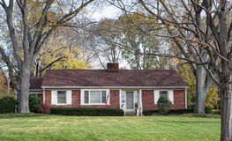 Brick Ranch House in Wooded Setting Royalty Free Stock Photos