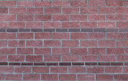 Brick red background with borders of narrow rectangular stone border texture. Brick red background with borders of narrow rectangular stone border symmetrical Stock Images
