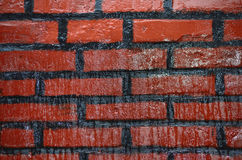 Brick. Red brick with black paint Royalty Free Stock Photography