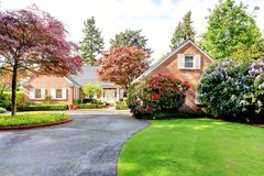Free Brick Red House With English Garden And White Window Shutters. Stock Image - 30607731