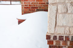 Brick residential home in snow Stock Photos