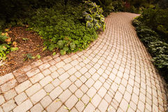 Brick Road. A gray curved converging brick road Royalty Free Stock Image
