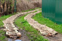 Brick road in green grass Stock Images