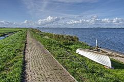 Brick road on a levee on the island of Marken royalty free stock photo