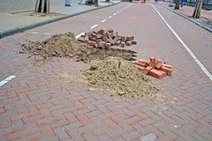 Brick road under repair, modern brick highway reconstruction, Stock Images