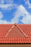 Brick roof. With clear cloud blue sky Stock Photos
