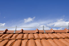 Brick roof and blue sky Stock Photography