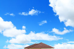 Brick roof with clear cloud blue sky Stock Image