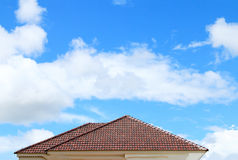Brick roof with clear cloud blue sky Stock Images