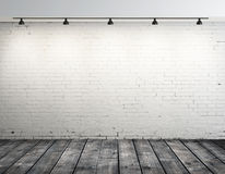 Brick room with ceiling lamp Stock Images