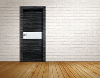 Brick room with modern door Royalty Free Stock Photography