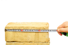Brick and ruler isolated on white Royalty Free Stock Photos