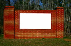 Brick Sign. A white sign on a brick background Royalty Free Stock Photo