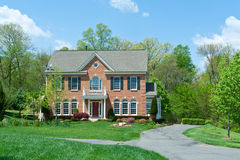 Brick Single Family House Home Suburban MD USA. Tidy Colonial Style single family house in suburban Maryland, United States.  House is brick faced and has a long Royalty Free Stock Images