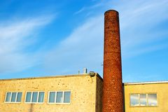 Brick smokestack. In old industrial building Royalty Free Stock Image
