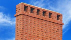 Big brick smokestack. Brick smokestack isolated on background of blue sky Royalty Free Stock Photography