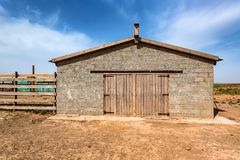 Brick stable on farm on sunny day. Stable building on farm, view from outside Stock Image