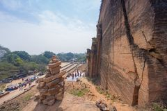 Brick stacking built to worship to the Mingun pagoda with tourist background below royalty free stock photos