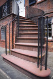 Brick staircase. With black metal hand rails leading to the front door of large home Royalty Free Stock Image