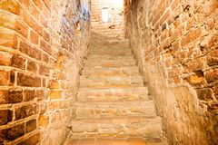 Brick staircase with stairs. In old castle corridor royalty free stock image