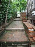 Brick stairs, high corridors beside open wooden windows. Design in outdoor garden royalty free stock photography